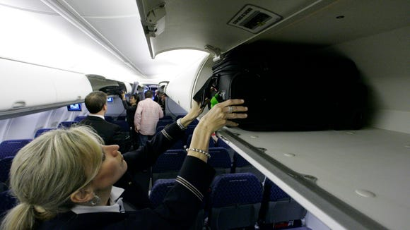 An American Airlines flight attendant  demonstrates