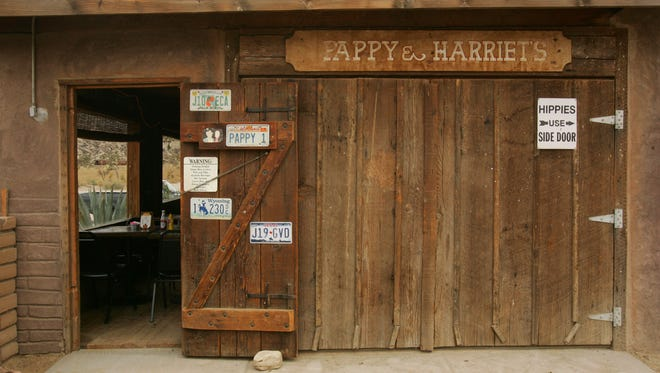 Crystal Chatham/The Desert Sun  08/07/2008 -- A sign on the back door of Pappy and Harriet's Pioneertown Palace points to a separate entrance for hippies on Thursday, August 7.