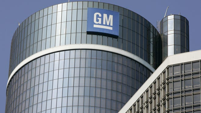 The GM logo on the top of the center tower at the GM Renaissance Center in Detroit