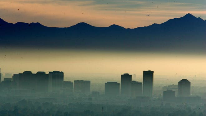 Smog smothers downtown Phoenix in 2006. Since ADEQ began keeping records in 2005, it has never issued a forecast for particulate levels to be as high as they're projected to be Jan. 1, 2018, said the agency's Tim Franquist.