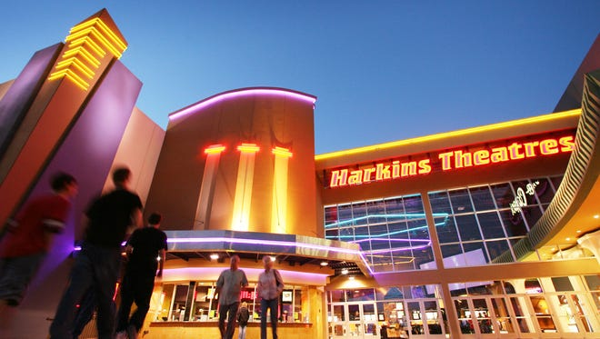 Neon lights illuminate the Harkins Theatres (Scottsdale 101 Luxury Cinemas) in Scottsdale.