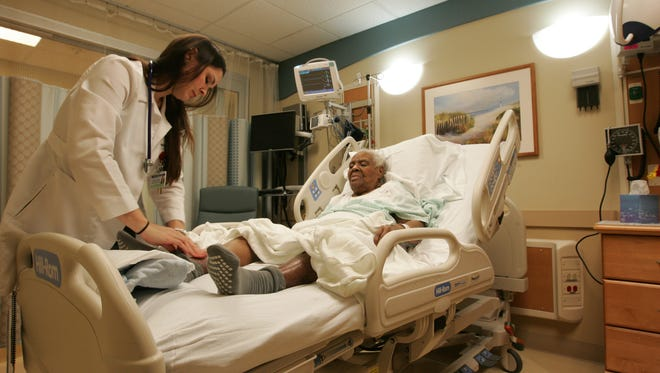 Angela Soldivieri, geriatric nurse practitioner, examines Ella Tillman, 84, of Long Branch in the Geriatric Emergency Medicine Unit at Monmouth Medical Center in Long Branch.