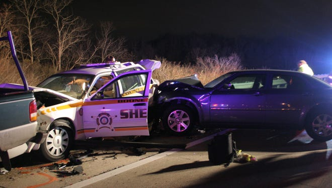 The four-vehicle crash sent four people, including a Boone County deputy, to the hospital.