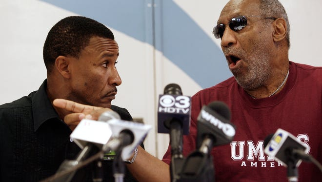 Rev. Derrick Johnson (left) with Bill Cosby who spoke to reporters at a 2007 event in Wilmington.