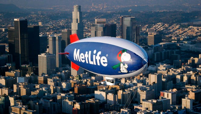 File photo taken in 2008 shows a MetLife blimp, with the logo of famed Peanuts cartoon character Snoopy, flying over Los Angeles.