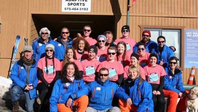 Tthe University of Missouri students with the coaches of SKi Apache Adaptive Sports.