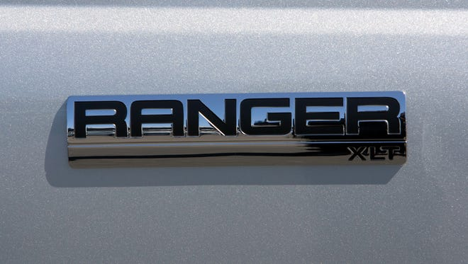 Ford Ranger pickup logo on the side of a vehicle parked on the lot at the Serramonte Ford dealership.