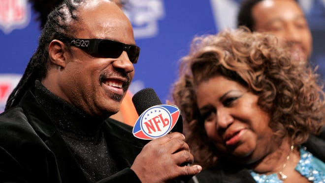 Stevie Wonder, who would sing in the pregame show, says how pleased he is to be with Aretha Franklin, right, and to be home in Detroit  on Feb. 2.    Franklin, Aaron Neville and Dr. John would join forces on the national anthem.
