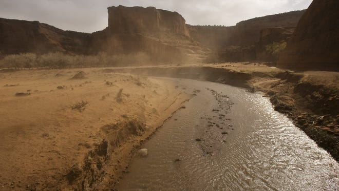 Wind kicks up dust near Chinle on the Navajo Reservation, an area hurt by drought.