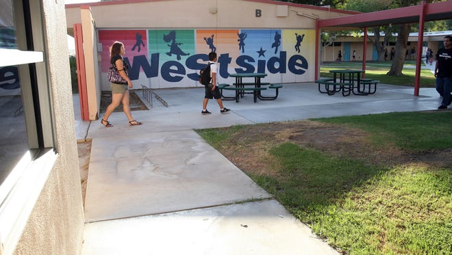 Westside Elementary School in Coachella Valley Unified School District has switched to bottled water after officials found chromium-6 in the water slightly above the state standard. A student walks to school in this Desert Sun file photo from 2011.