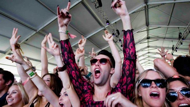 Fans enjoying a Coachella act in the Gobi Stage.   Omar Ornelas/ The Desert