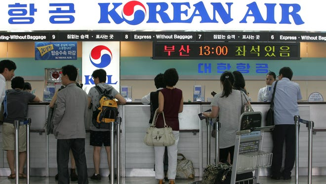 Passengers wait at the Korean Air ticket and check-in desk at Gimpo Airport on Aug. 7, 2009 in Gimpo, South Korea.