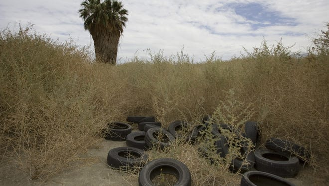 This 2012 photo shows a lot in Coachella that was used as an illegal dump, one of many such dumps that have appeared in the Coachella Valley in recent years. The website IVAN Online offers one way for people to report illegal dumps and other potential environmental violations to local and state authorities.