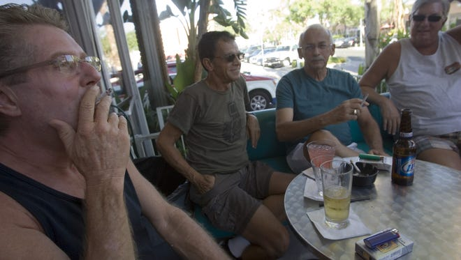 Patrons at Streetbar in Palm Springs smoke on the patio area, Wednesday, July 25, 2012.