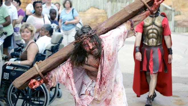 In this file photo, Les Cheveldayoff portrays Jesus during a performance of the Crucifixion, as a somber audience watches at the Holy Land Experience, a Christian-themed attraction in Orlando, Florida, July 13, 2007.