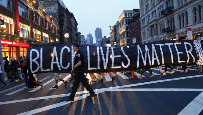 A police officer patrols during a July 9 Black Lives Matter demonstration in New York.