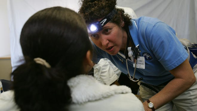 Dr. Audrey D'Andrea  examines a patient during a Flying Doctors free clinic in Thermal in 2009.