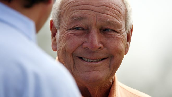 Arnold Palmer talks to a fan during a charity golf fundraiser Monday, March 24, 2008, at Calusa Pines Golf Club in North Naples. The event benefitted the Cancer Alliance of Naples and featured Arnold Palmer other pros such as Peter Jacobsen, Rocco Mediate and 2008 U.S. Ryder Cup captain Paul Azinger.