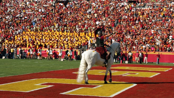LOS ANGELES - OCTOBER 29:  Rider Chuck O'Donnell aboard Traveler VII, mascot of the USC Trojans points to the crowd from the end zone during the game against the Washington State Cougars on October 29, 2005 at the Los Angeles Memorial Coliseum in Los Angeles, California.