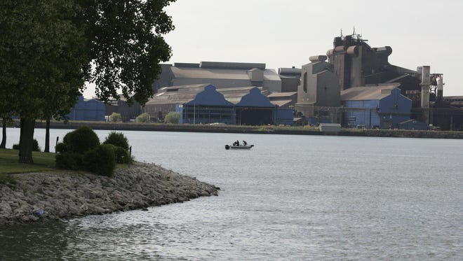 Fishermen fish in the Detroit River in front of the U.S. Steel plant on Zug Island on Tuesday, June 2, 2009. Canada's Fighting Island is seen at left in photo.