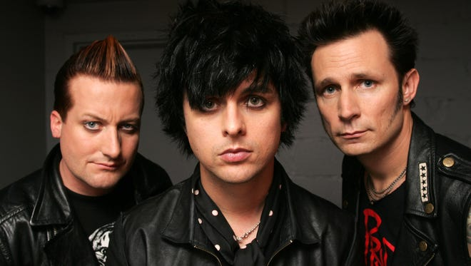 In this May 15, 2009, file photo, Green Day members, from left, Tre Cool, Billie Joe Armstrong and Mike Dirnt pose at the Mercer Hotel in New York. (AP Photo/Bruce Gilbert, file)