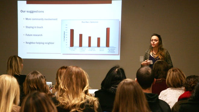 Danielle Glunt, a senior at Missouri State University, presents study findings to the Doling Neighborhood Association on December 15, 2016 at the Doling Faimly Center. Dr. Mary Ann Jennings social work class conducted a semseter long study of the neighborhood. Part of that study included finding out how neighbors can be digitally connected.