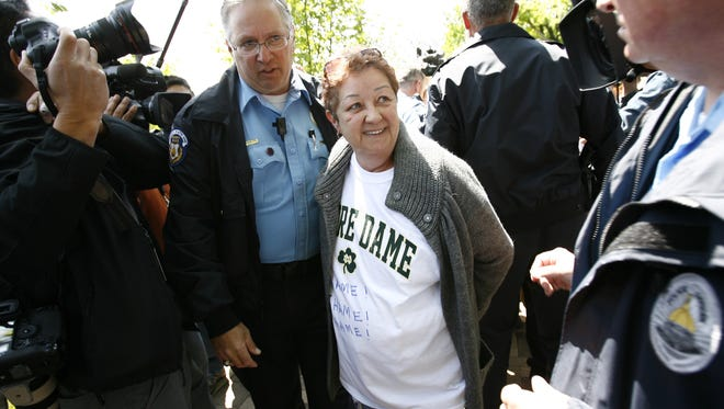 """Norma McCorvey, known as the """"Roe"""" in Roe V. Wade, is arrested just inside the gate of Notre Dame, on the day President Barack Obama is due to speak to students at the day's commencement ceremony, South Bend, Ind.,  May 17. 2009."""