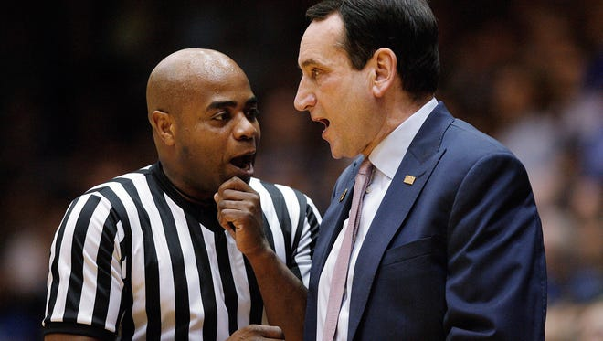 Rochester's Jeffrey Anderson, left, shown talking over a call a couple seasons ago with Duke coach Mike Krzyzewski at Cameron Indoor Stadium, is one of 10 men who have been selected to officiate at the Final Four on Saturday in Phoenix.