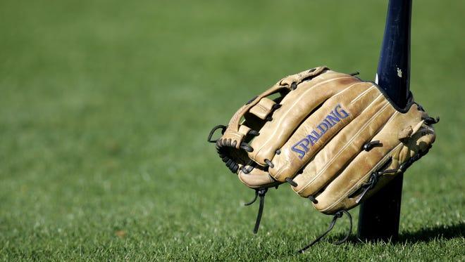 A baseball bat and a glove.