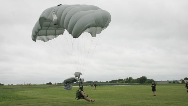 Members of the 5th Special Forces Group at Fort Campbell practice skydiving under coaching by the Golden Knights in 2009.