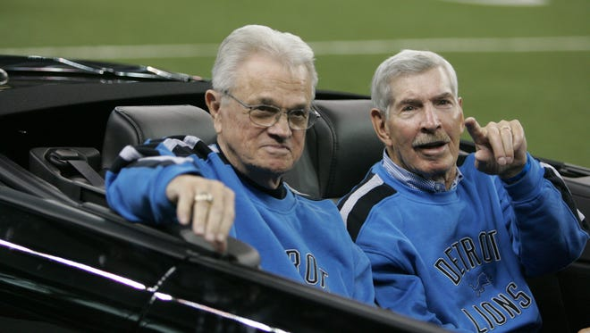 1957 Detroit Lions Yale Lary, left, and Gary Lowe wave to the fans during the halftime 50th anniversary celebration for  the Lions' last championship in 50 years in 2007.