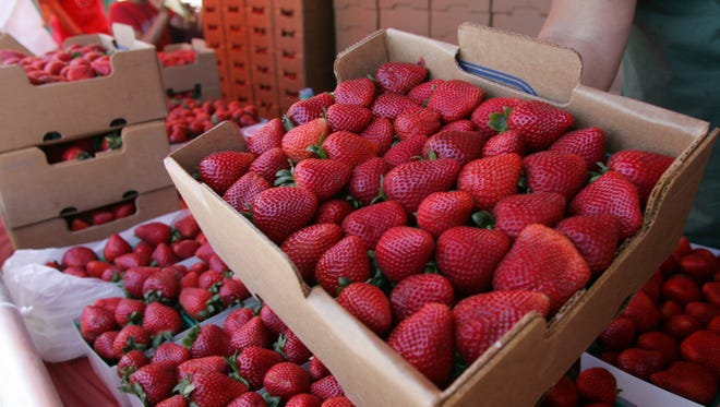 Fresh strawberries from Nakamura Berry Growers are on display Saturday during the California Strawberry Festival in Oxnard.