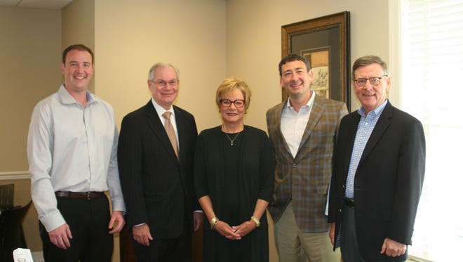 Pictured from left to right: Bradley Barrett Jr., former Bank employee Tim Amos, long-time Senior Vice President and General Counsel, as well as chief lobbyist, for the TBA.; Debbie Small, Colin Barrett, Executive Director of the TBA; Brad Barrett, former Executive Director of the TBA.