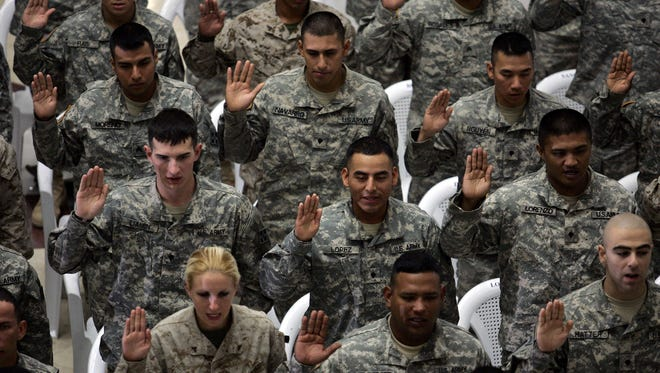A diverse group of U.S. soldiers are sworn in as citizens in 2006.