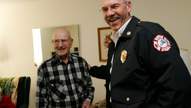 Former firefighter Merton Schulz, 98, with Appleton Fire Chief Len Vander Wyst in 2010.