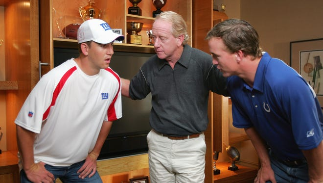 From left, Eli, Archie and Peyton Manning on the set of  a Reebok commercial shoot on June 26, 2006 in North Caldwell, N.J.