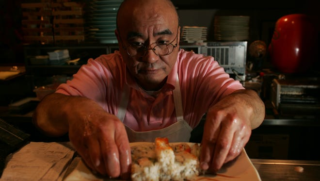 By Tom Leininger/Journal and Courier--Tony Yamazaki, owner of Kokoro, makes sushi at his downtown Lafayette restaurant Thursday, March 30, 2006. Kokoro won the 2006 Bragging Rights for best sushi. (30 march 06)