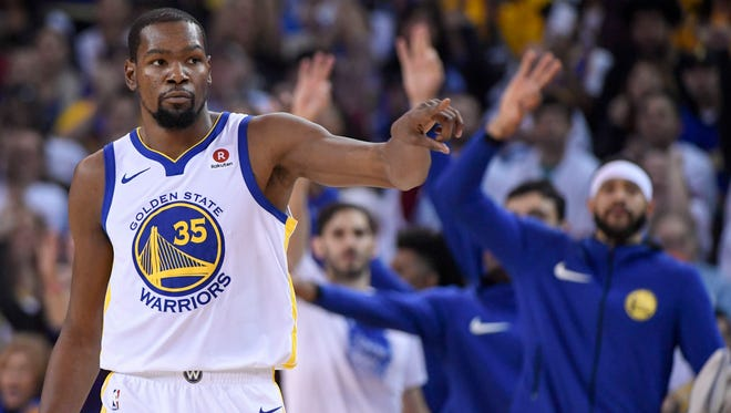 Golden State Warriors forward Kevin Durant (35) celebrates after making a basket against the Cleveland Cavaliers during the first quarter at Oracle Arena.