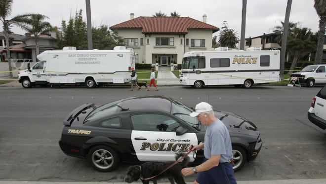 Coronado police and the sheriff investigate the scene of a death at the old Spreckels Mansion on July 14, 2011, on Ocean Boulevard in Coronado.