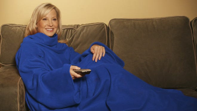"""In this product image provided by Allstar Products Group, a """"Snuggie"""" is modeled."""