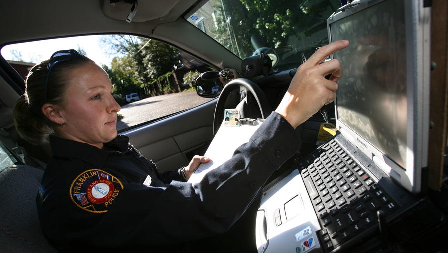 Franklin police officer Leigh Ann Hester checks a motorist's