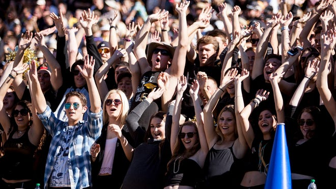 Saguaro fans cheer for the Sabercats during the Division III state championship game on Saturday, Nov. 29, 2014, at Sun Devil Stadium in Tempe, Ariz.