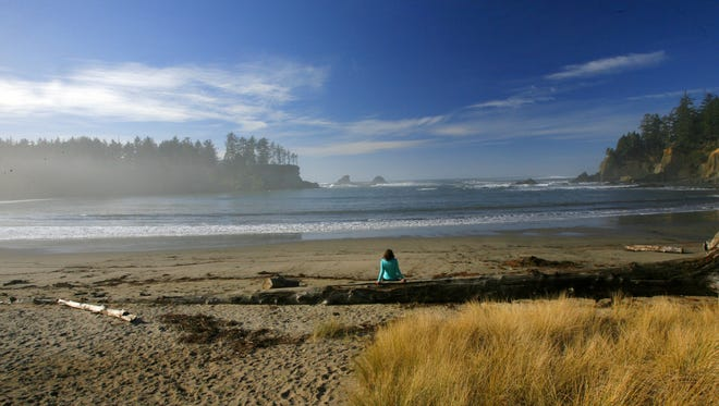 The beach at Sunset Bay State Park can offer sunny, warm days even in winter.