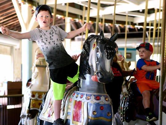 Jacob Shipman rides the carousel at Eldridge Park in