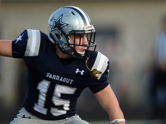 Farragut's Kyle Carter (15) celebrates a touchdown