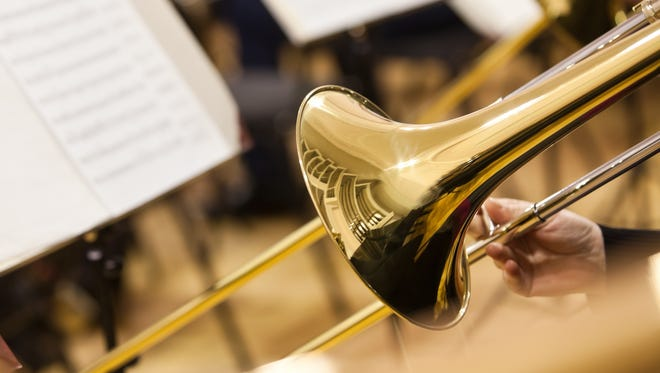 Detail of a trombone in the hands of the musician closeup