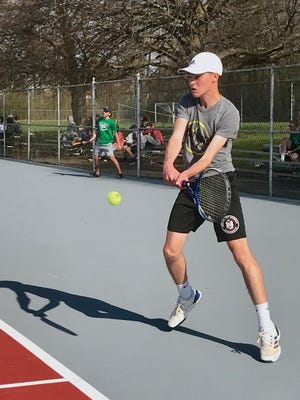 Marion Harding's Nathan Longstreth returns a serve against Clear Fork's Noah Brown Friday evening at home in a No. 1 singles match. The Presidents hosted the MOAC Tournament the next day and finished third as a team.