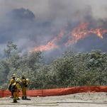 San Diego wildfires force thousands from their homes
