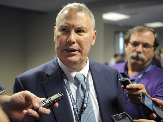 This Sept. 17, 2016 photo shows Michael Aresco, commissioner of the American Athletic Conference, speaking to reporters in the press box of Pratt & Whitney Stadium at Rentschler Field before an NCAA college football game between Connecticut and Virginia in East Hartford, Conn. The American Athletic Conference wants to be considered a power conference and released a strategic plan on Monday, May 1, 2017 designed to help it improve its stature. The plan sets goals for athletics, academics, health and safety, marketing and for generating more revenue. (AP Photo/Jessica Hill)