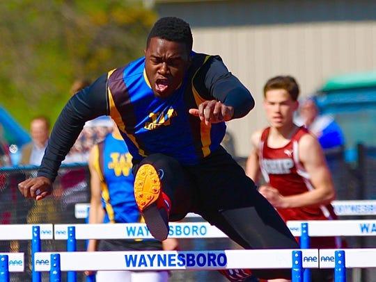 Waynesboro's Ogo Akamelu clears a hurdle against Shippensburg